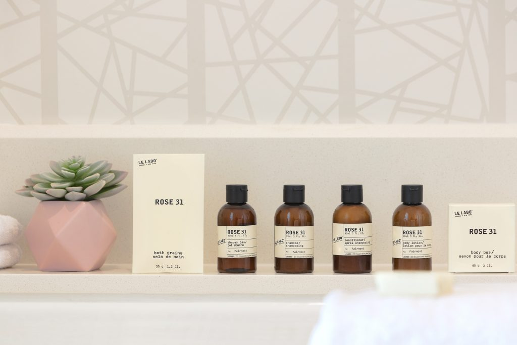 Close up complimentary of Le Labo for Fairmont branded bath accessories along bathtub edge