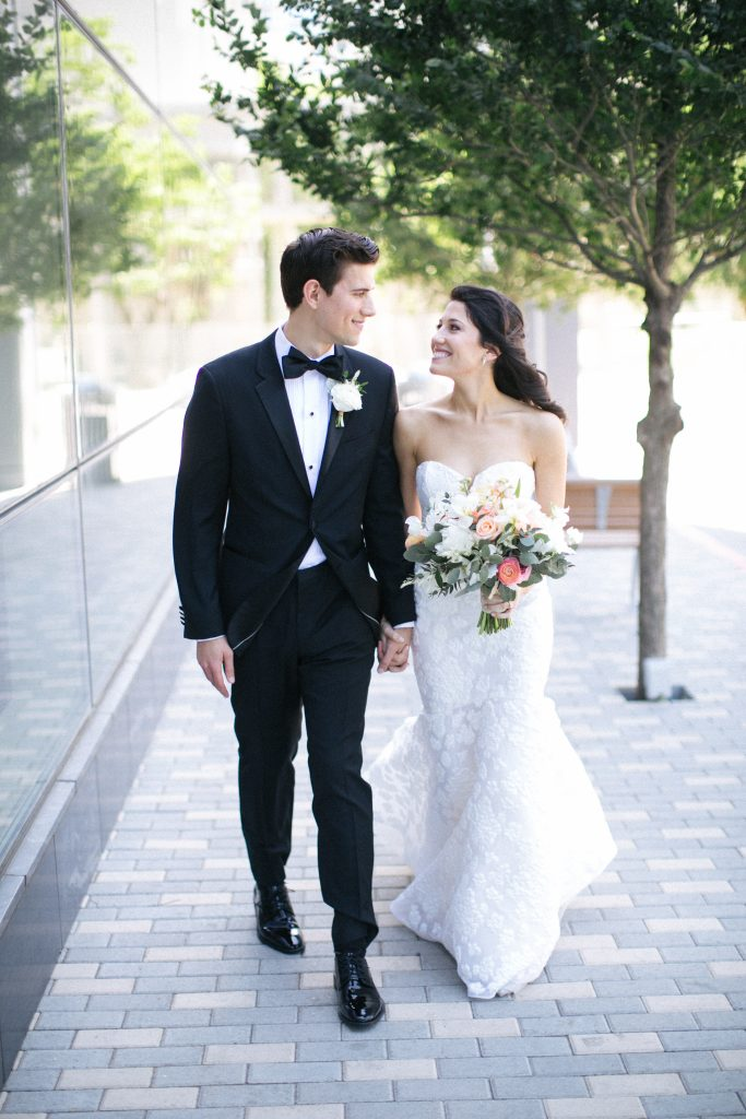 bride and groom outside at fairmont austin