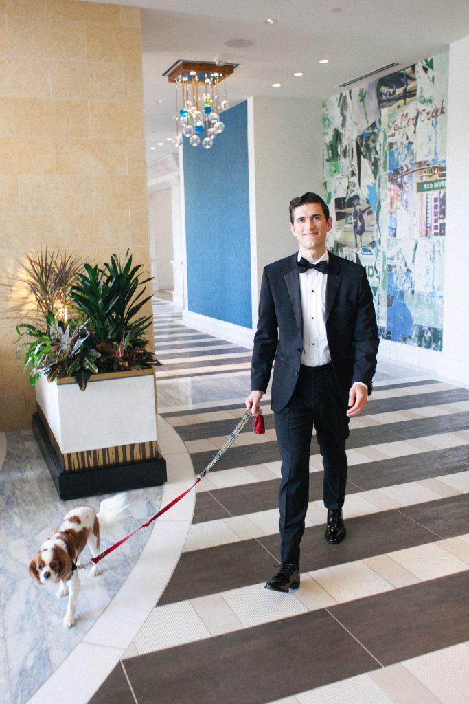 groom and dog