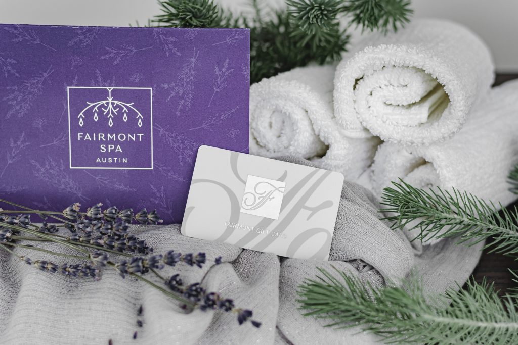 Fairmont Spa gift card and envelope presented with lavender and evergreen sprigs and luxurious towels