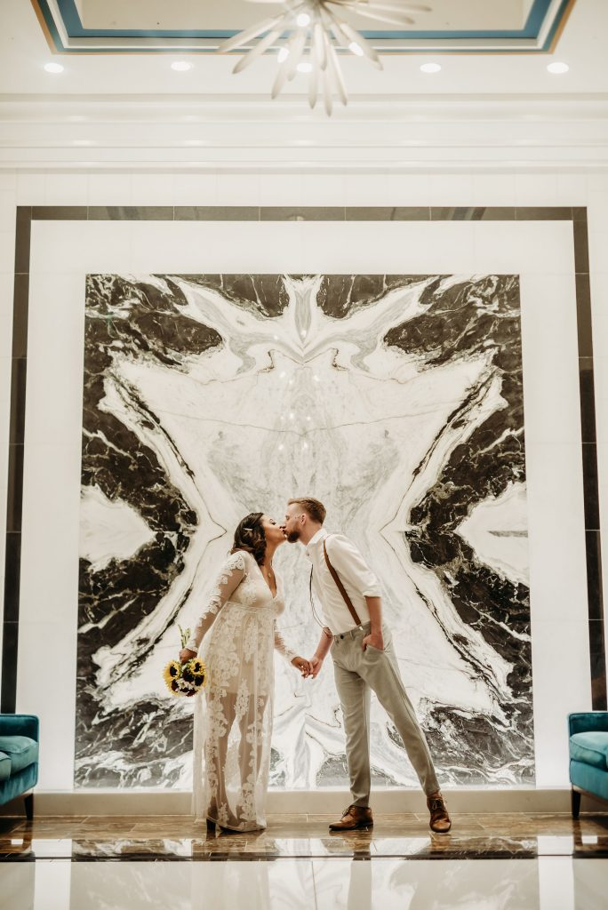 bride and groom kissing at fairmont austin