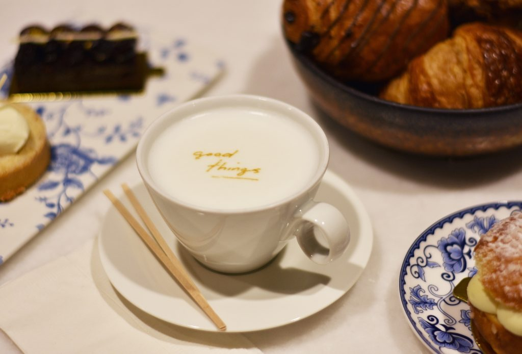 Close up of coffee with Good Things logo showing delicately in the cream
