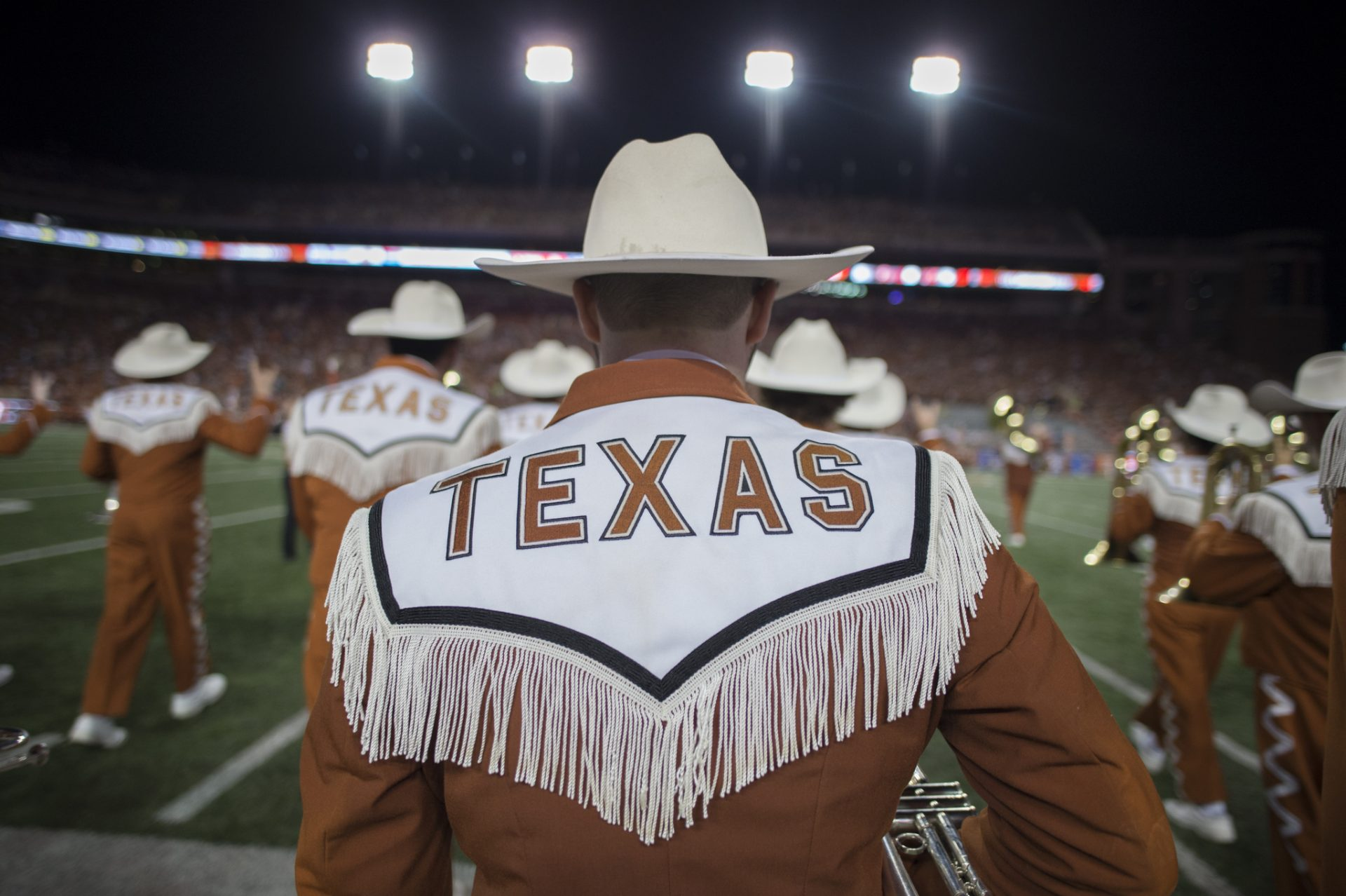 texas athletic cheerleader wearing cowboy hat on the football field