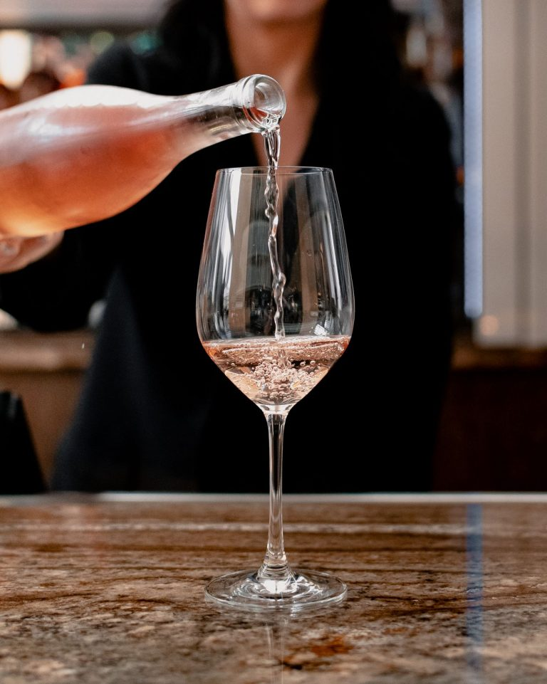 rose wine being poured by a bartender