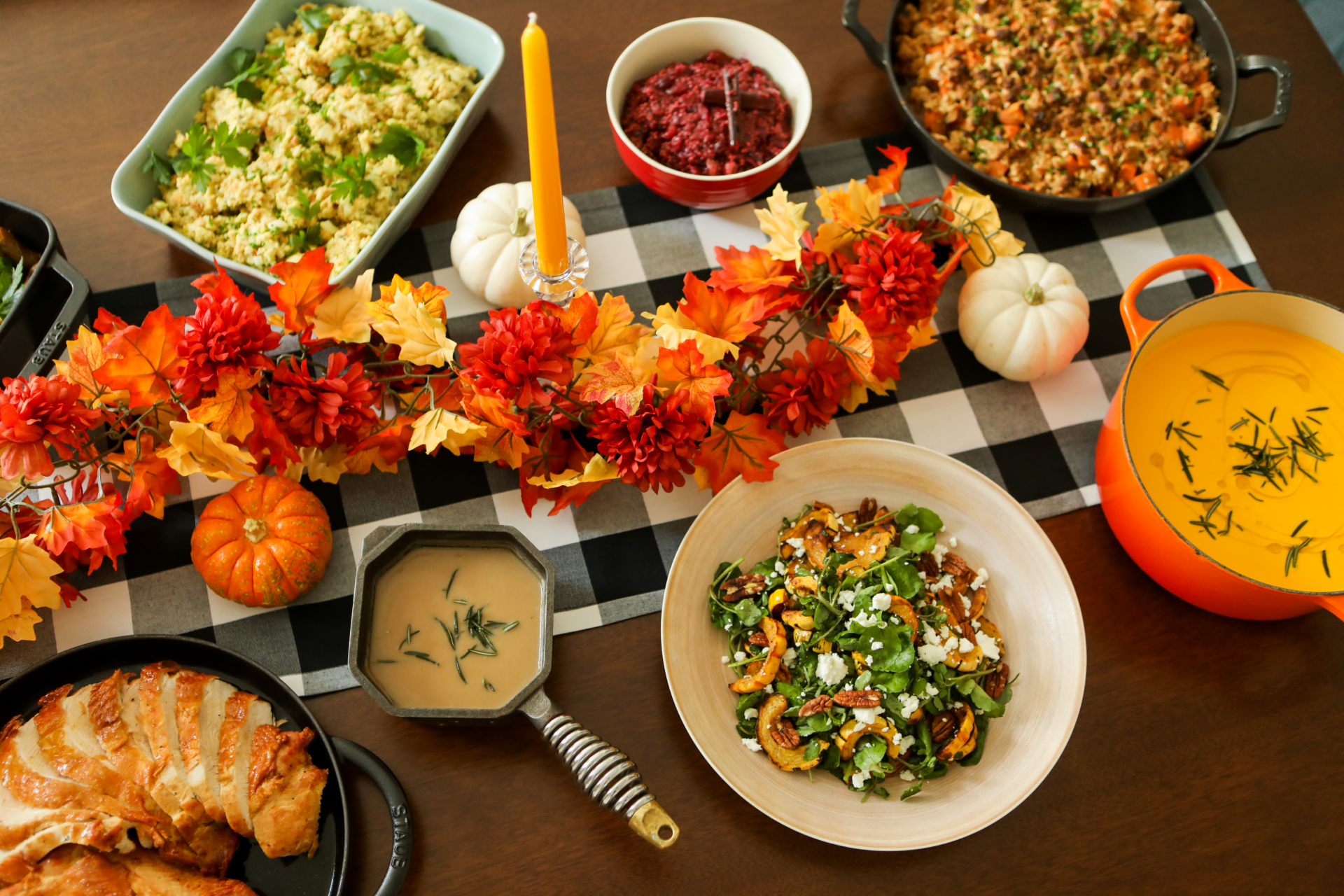 thanksgiving to go mean plated on a festive table with autumn leaves and pumpkins and fall candles