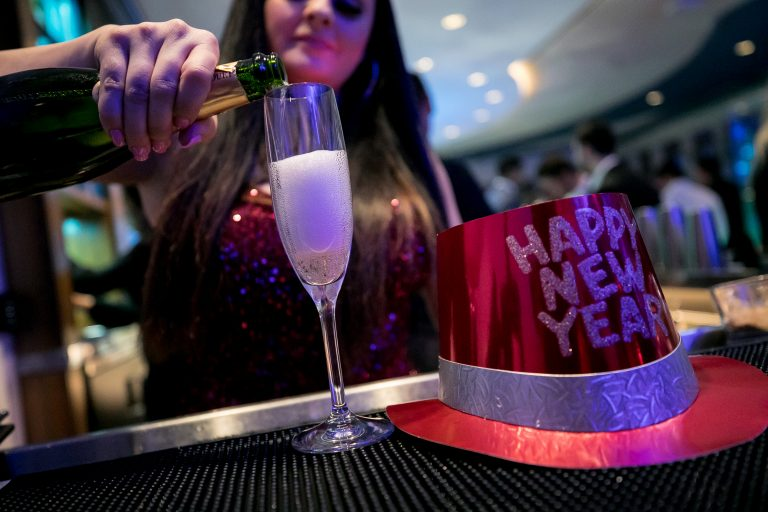 a bartender pouring champagne for new years at fairmont austin