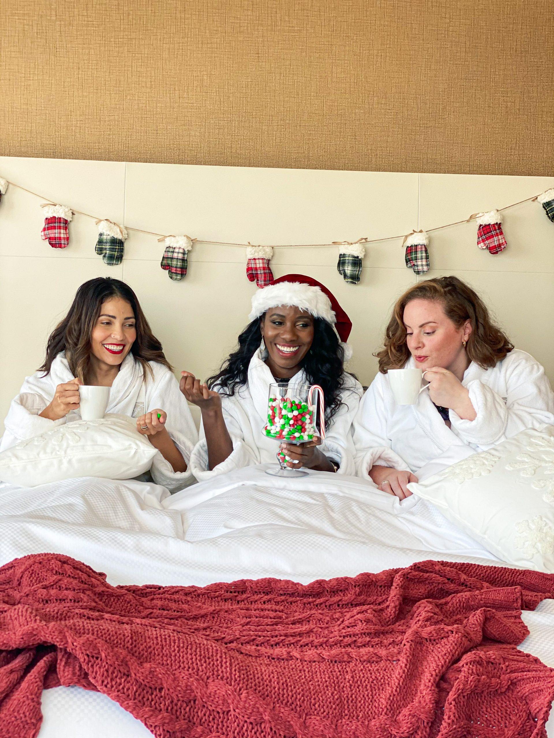 three women in robes enjoying fairmont austin's santa suite