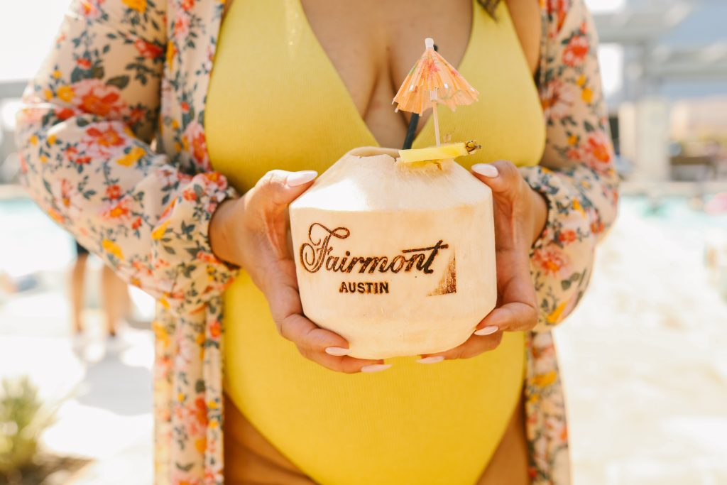 woman holding coconut cocktail