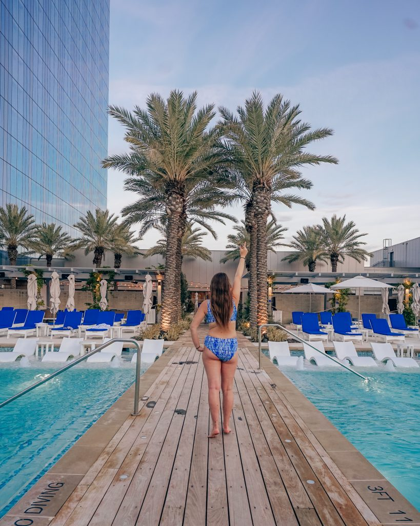 woman lounging by pool at fairmont austin