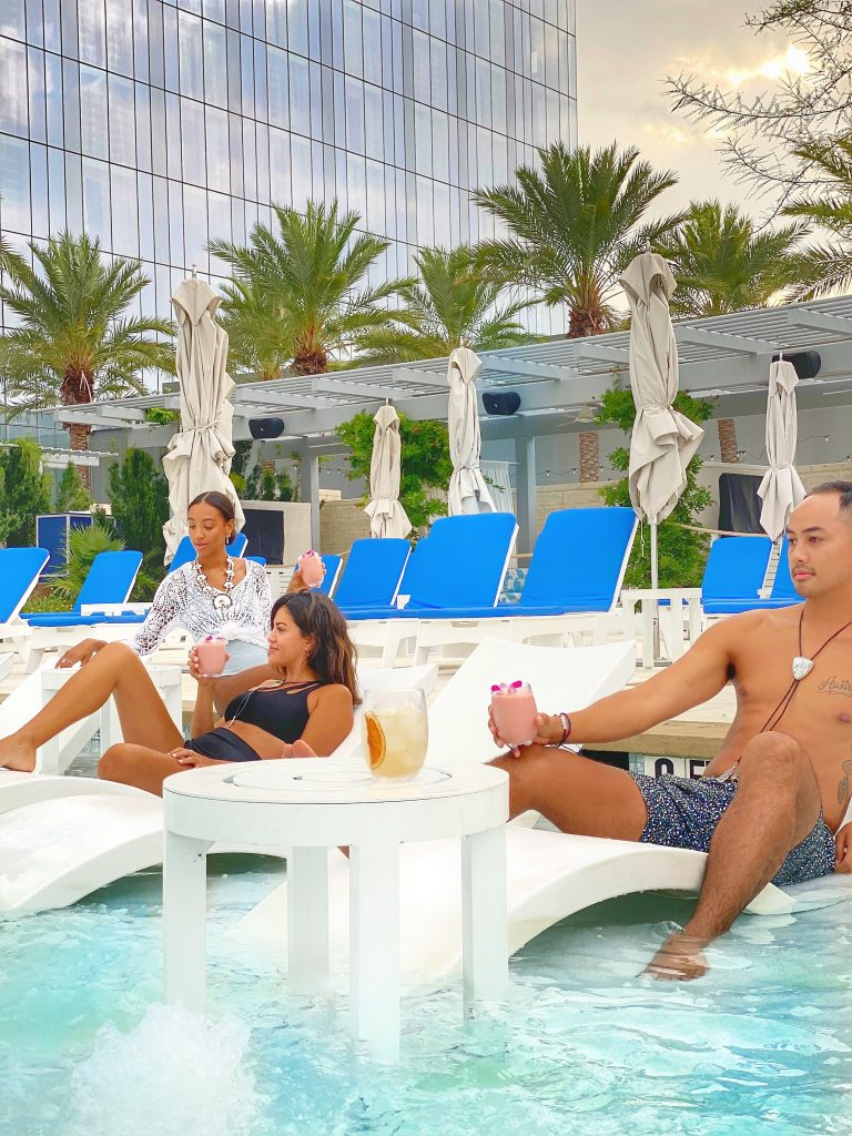 friends lounging by fairmont austin pool