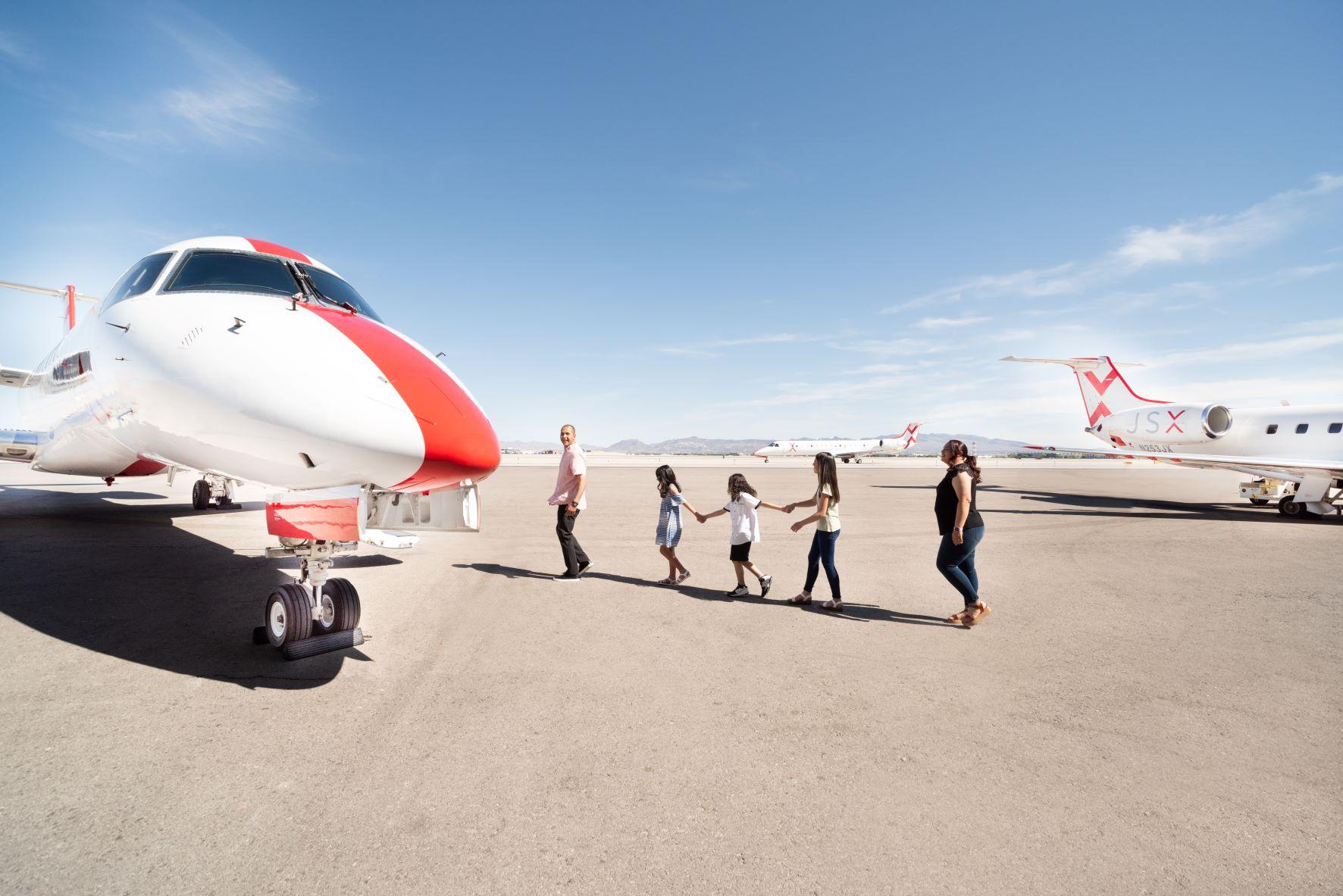 family boarding JSX flight